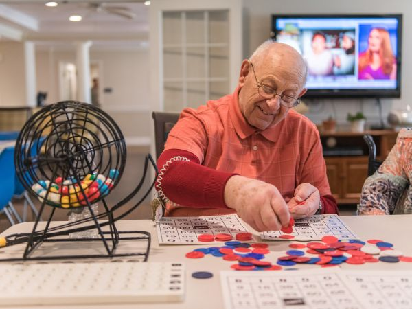 Man Playing Bingo at Kingston Residence of Sylvania