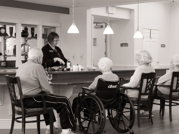 Residents Sitting at Bar | Kingston Assisted Living in Marion
