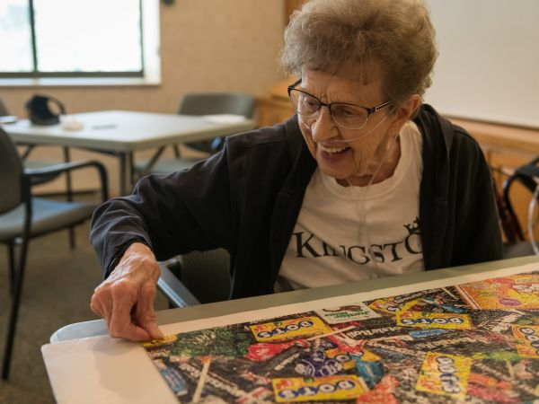 Woman Enjoys Doing a Puzzle at Kingston | Senior Living in Fort Wayne, IN