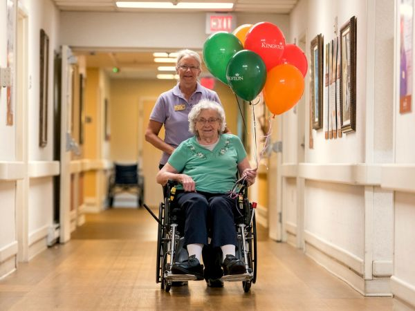Resident With Balloons | Kingston Care Center of Fort Wayne