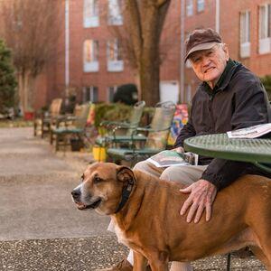 Resident & Dog Enjoying Outdoor Courtyard   Kingston in Hickory