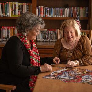 Resident Enjoying a Puzzle   Kingston Residence of Hickory