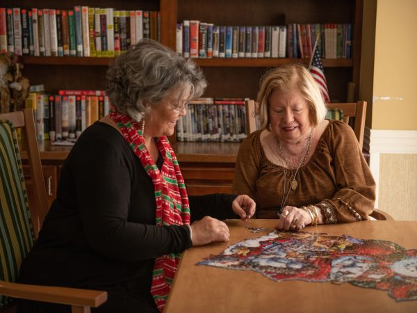 Resident Enjoying a Puzzle | Kingston Residence of Hickory